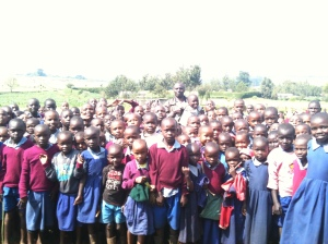 primary school children with their head teacher in Nandi East
